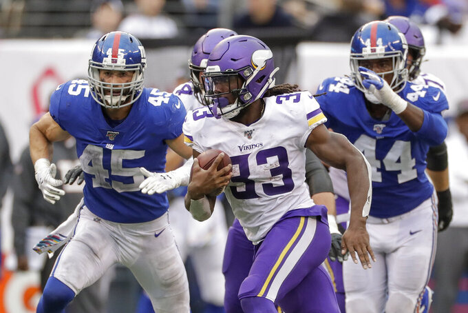 Minnesota Vikings running back Dalvin Cook (33) runs the ball against the New York Giants during the fourth quarter of an NFL football game, Sunday, Oct. 6, 2019, in East Rutherford, N.J. (AP Photo/Adam Hunger)