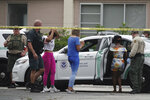 U.S. Border Patrol officials detain some of the multiple migrants who came ashore on the intracoastal waterway, Thursday, June 17, 2021, in Pompano Beach, Fla. (Joe Cavaretta/South Florida Sun-Sentinel via AP)