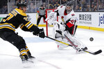 Ottawa Senators goaltender Craig Anderson, right, clears the puck away from Boston Bruins center Patrice Bergeron (37) during the second period of an NHL hockey game in Boston, Saturday, Nov. 2, 2019. (AP Photo/Charles Krupa)