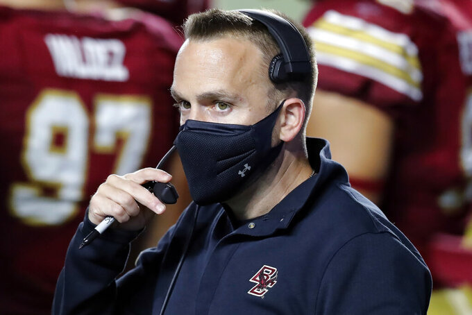 Boston College coach Jeff Hafley wears a mask during the first half of the team's NCAA college football game against Texas State, Saturday, Sept. 26, 2020, in Boston. (AP Photo/Michael Dwyer)