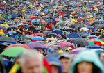 Pilgrims hold umbrellas during a heavy rainfall before Pope Francis' Mass at the Marian shrine, in Sumuleu Ciuc, Romania, Saturday, June 1, 2019. Francis began a three-day pilgrimage to Romania on Friday that in many ways is completing the 1999 trip by St. John Paul II that marked the first-ever papal visit to a majority Orthodox country. (AP Photo/Vadim Ghirda)