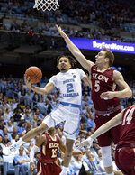 North Carolina's Cole Anthony (2) attempts a shot as Elon's Federico Poser (5) defends during the first half of an NCAA college basketball game in Chapel Hill, N.C., Wednesday, Nov. 20, 2019. (AP Photo/Ben McKeown)