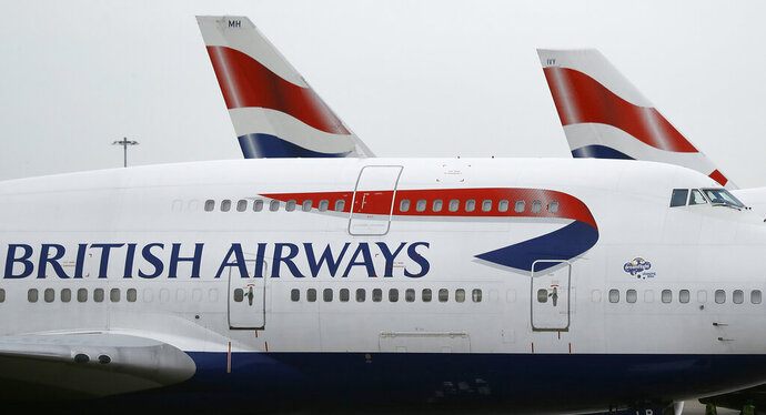 FILe - In this file photo dated Tuesday, Jan. 10, 2017, British Airways planes are parked at Heathrow Airport in London.  The U.K. data regulator, the Information Commissioner's Office said Monday July 8, 2019, it is fining British Airways 183 million pounds (dollars 229 million US) over a breach that compromised information on half a million customers. (AP Photo/Frank Augstein, FILE)