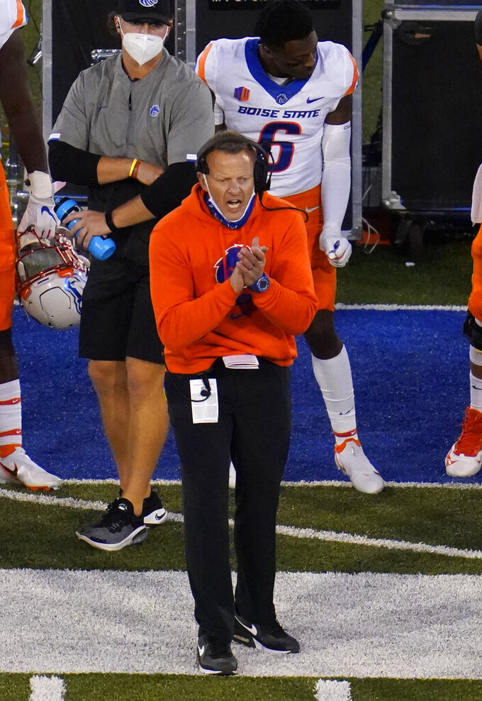 Boise State head coach Bryan Harsin applauds during the second half of the team's NCAA college football game against Air Force on Saturday, Oct. 31, 2020, at Air Force Academy, Colo. (AP Photo/David Zalubowski)