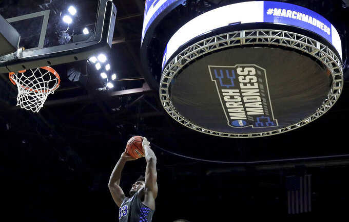 Buffalo's Nick Perkins shoots during the first half of a second round men's college basketball game against Texas Tech in the NCAA Tournament Sunday, March 24, 2019, in Tulsa, Okla. (AP Photo/Charlie Riedel)