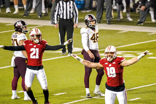 Minnesota kicker Andres Gelecinskyj (48) reacts after his field goal attempt failed during overtime of an NCAA college football game against Wisconsin, Saturday, Dec. 19, 2020, in Madison, Wis. (AP Photo/Andy Manis)