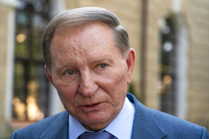 Former Ukrainian President Leonid Kuchma speaks during an interview with The Associated Press in Kiev, Ukraine, Friday, Sept. 13, 2019. Kuchma told The Associated Press Friday that he is concerned that the leaders of France and Germany who mediate talks between Russia and Ukraine will push President Volodymyr Zelenskiy to make unacceptable trade-offs to Russia. (AP Photo/Evgeniy Maloletka)