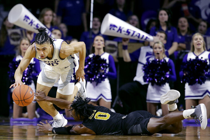 Kansas State's Mike McGuirl (00) steals the ball from Alabama State's D.J. Heath (0) during the second half of an NCAA college basketball game Wednesday, Dec. 11, 2019, in Manhattan, Kan. (AP Photo/Charlie Riedel)