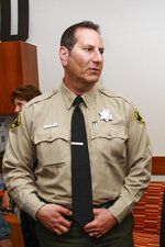 In this April 13, 2016 image, Former San Diego County Sheriff's Capt. Marco Garmo is seen in San Diego. Federal agents have arrested Garmo along with a deputy and several others in connection to gun trafficking. (Hayne Palmour IV/The San Diego Union-Tribune via AP)