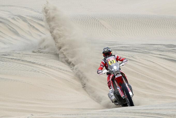 Kevin Benavides of Argentina rides his Honda motorbike across the dunes during the second stage of the Dakar Rally between Pisco and San Juan de Marcona, Peru, Tuesday, Jan. 8, 2019. (AP Photo/Ricardo Mazalan)
