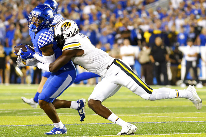 Kentucky wide receiver Wan'Dale Robinson (1) gets tackled during the first half of an NCAA college football game against Missouri in Lexington, Ky., Saturday, Sept. 11, 2021. (AP Photo/Michael Clubb)