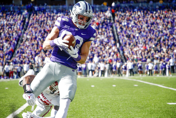 Kansas State wide receiver Dalton Schoen (83) catches a pass as Oklahoma defensive back Brendan Radley-Hiles (44) defends during NCAA football game at Bill Snyder Family Stadium in Manhattan, Kan., Saturday, Oct. 26, 2019. (Ian Maule/Tulsa World via AP)