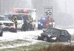 DeKalb County Sheriff's deputies and DeKalb firefighters and paramedics respond to a car in the ditch on Route 23 just south of Gurler Road as snow and wind continue to make driving hazardous in DeKalb Thursday, Oct. 31, 2019. A Halloween snow storm blanketed much of the area with ice and snow Wednesday night into Thursday.  (Mark Busch/Daily Chronicle via AP)