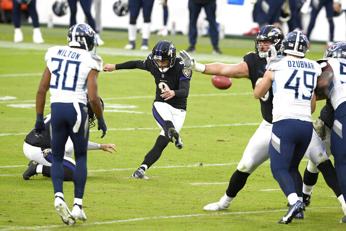 Baltimore Ravens kicker Justin Tucker kicks a field goal against the Tennessee Titans during the second half of an NFL football game, Sunday, Nov. 22, 2020, in Baltimore. (AP Photo/Nick Wass)