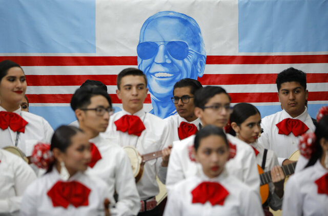 FILE - In this Jan. 11, 2020, file photo, a Mariachi band waits to perform before a campaign event with former Vice President and Democratic presidential candidate Joe Biden in Las Vegas. In Joe Biden's pursuit of the Democratic presidential nomination, he's run repeatedly into a wall in the West, where Bernie Sanders' strength among Latinos propelled his campaign even as he struggled with other groups. Tuesday's primaries in Arizona and Florida offer Biden a chance to show he can make up ground with Latinos, a crucial group of voters he'll need in his corner to defeat Trump (AP Photo/John Locher, File)