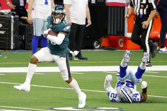 Philadelphia Eagles' DeSean Jackson (10) catches a long pass and gets past Dallas Cowboys cornerback Chidobe Awuzie (24) on his way to the end zone for a touchdown in the first half of an NFL football game in Arlington, Texas, Sunday, Dec. 27. 2020. (AP Photo/Michael Ainsworth)