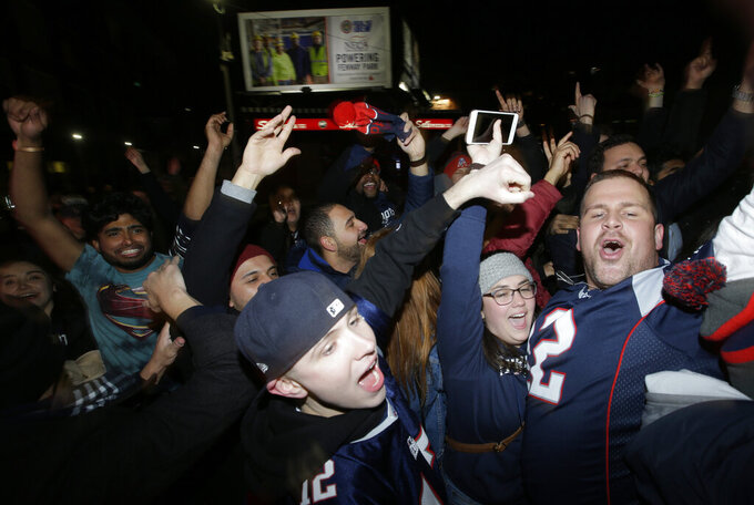 New England Patriots fans celebrate after the Patriots defeated the Los Angeles Rams in the NFL Super Bowl 53 football game in Atlanta in Boston on Sunday, Feb. 3, 2019. (AP Photo/Steven Senne)