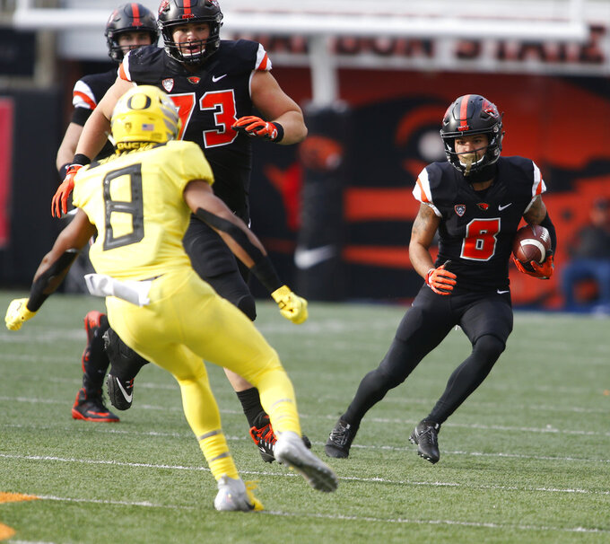 Oregon State wide receiver Trevon Bradford (8) tries to get past Oregon safety Jevon Holland (8) in the first half of an NCAA college football game in Corvallis, Ore., on Friday, Nov. 23, 2018. (AP Photo/Timothy J. Gonzalez)