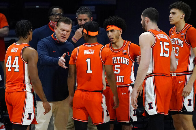 Illinois head coach Brad Underwood, second from left, talks to his team during the first half of an NCAA college basketball game against Northwestern in Evanston, Ill., Thursday, Jan. 7, 2021. (AP Photo/Nam Y. Huh)