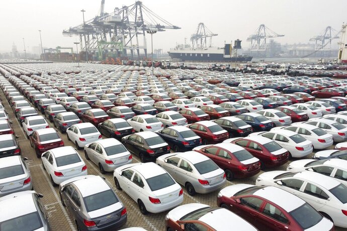 New cars wait to be transported from a port Yantai in east China's Shandong province Wednesday, Oct. 21, 2020. China's manufacturing activity expanded in October for the eighth straight month, though at a slightly slower rate than in September, the National Bureau of Statistics said Saturday, Oct. 31, 2020. (Chinatopix Via AP) CHINA OUT