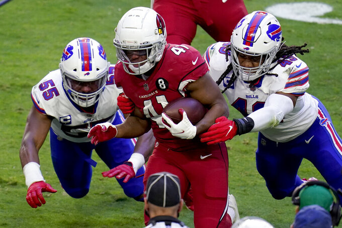 Arizona Cardinals running back Kenyan Drake (41) runs as Buffalo Bills linebacker Del'Shawn Phillips (43) and defensive end Jerry Hughes (55) defend during the first half of an NFL football game, Sunday, Nov. 15, 2020, in Glendale, Ariz. (AP Photo/Ross D. Franklin)