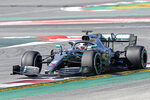 Mercedes driver Lewis Hamilton of Britain steers his car during a Formula One pre-season testing session at the Catalunya racetrack in Montmelo, outside Barcelona, Spain, Tuesday, Feb. 26, 2019. (AP Photo/Joan Monfort)