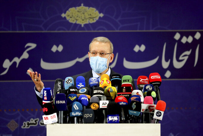 Former Iranian parliament speaker Ali Larijani attends a news conference after registering his candidacy for the June 18 presidential elections at the elections headquarters of the Interior Ministry in Tehran, Iran, Saturday, May 15, 2021. (AP Photo/Ebrahim Noroozi)