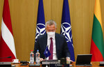 NATO Secretary General Jens Stoltenberg chairs on on-line meeting of NATO Foreign Ministers at NATO headquarters in Brussels, Tuesday, June 1, 2021. (Johanna Geron, Pool via AP)