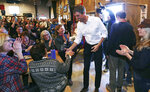 Former Texas congressman Beto O'Rourke shakes hands during a campaign stop at a brewery in Conway, N.H., Wednesday, March 20, 2019. O'Rourke announced last week that he'll seek the 2020 Democratic presidential nomination. (AP Photo/Charles Krupa)
