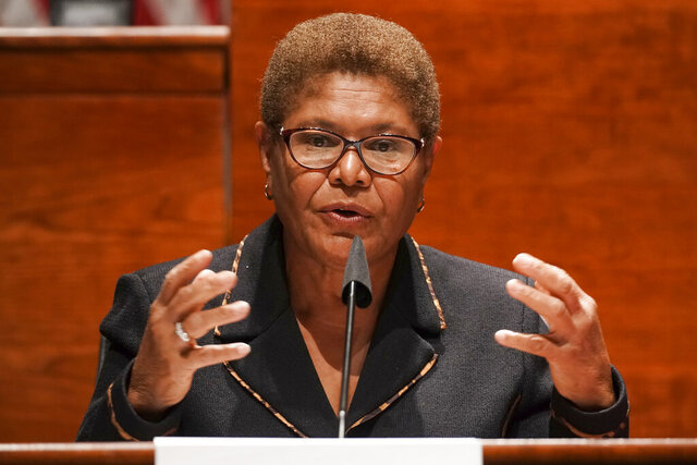FILE - In this June 17, 2020, file photo, Rep. Karen Bass, D-Calif., speaks on Capitol Hill in Washington. The fight over who would fill a potential vacancy in one of California's U.S. Senate seats had gone public, with a Hispanic group openly pressuring Gov. Gavin Newsom to pick a Latino. The seat now held by Sen. Kamala Harris, Joe Biden's choice for vice president. A long list of possible contenders includes Rep. Karen Bass, who was on Biden's vice presidential shortlist and heads the Congressional Black Caucus. (Greg Nash/Pool Photo via AP, File)