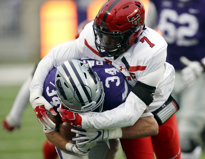Kansas State running back Alex Barnes (34) is tackled by Texas Tech defensive back Jah'Shawn Johnson (7) during the first half of an NCAA college football game in Manhattan, Kan., Saturday, Nov. 17, 2018. (AP Photo/Orlin Wagner)