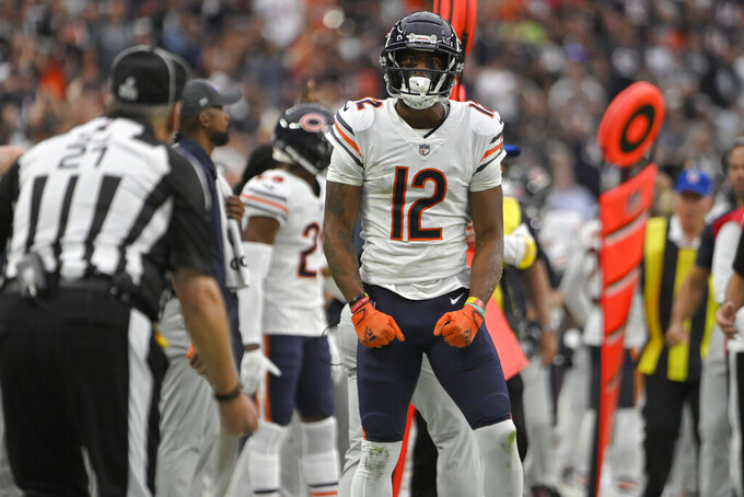 Chicago Bears wide receiver Allen Robinson (12) celebrates after making a catch against the Las Vegas Raiders during the first half of an NFL football game, Sunday, Oct. 10, 2021, in Las Vegas. (AP Photo/David Becker)