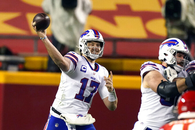 FILE - In this Sunday, Jan. 24, 2021 file photo, Buffalo Bills quarterback Josh Allen throws a pass during the second half of the AFC championship NFL football game against the Kansas City Chiefs in Kansas City, Mo. Buffalo Bills quarterback Josh Allen is still debating whether to receive the COVID-19 vaccine, and believes the decision be left to personal choice. Allen shared his views Wednesday, April 7, 2021 during an hour-long interview on The Ringer podcast hosted by Kyle Brandt, when asked about the NFL electing not mandate its players to be vaccinated. (AP Photo/Charlie Riedel, File)