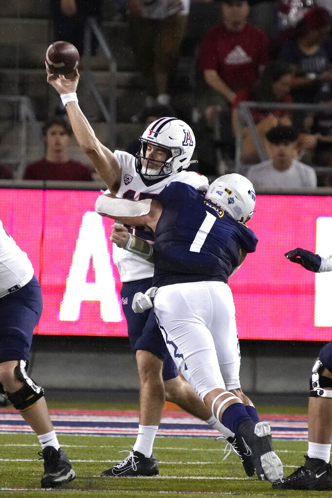 Northern Arizona defensive lineman Carson Taylor (1) pressures Arizona quarterback Will Plummer in the first half of an NCAA college football game, Saturday, Sept. 18, 2021, in Tucson, Ariz. (AP Photo/Rick Scuteri)