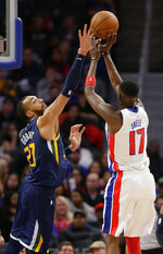 Utah Jazz center Rudy Gobert (27) defends against a shot by Detroit Pistons forward Tony Snell (17) during the second half of an NBA basketball game Saturday, March 7, 2020, in Detroit. (AP Photo/Duane Burleson)