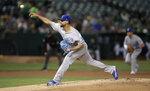 Kansas City Royals pitcher Jorge Lopez works against the Oakland Athletics during the first inning of a baseball game Tuesday, Sept. 17, 2019, in Oakland, Calif. (AP Photo/Ben Margot)
