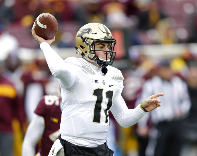 Purdue quarterback David Blough passes against Minnesota in the first quarter of an NCAA college football game Saturday, Nov. 10, 2018, in Minneapolis. (AP Photo/Andy Clayton-King)