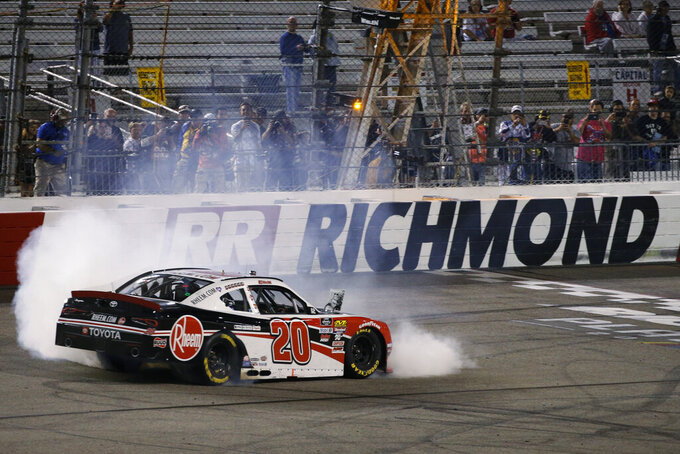 Christopher Bell does a burnout as he celebrates winning the NASCAR Xfinity Series auto race at Richmond Raceway in Richmond, Va., Friday, Sept. 20, 2019. (AP Photo/Steve Helber)