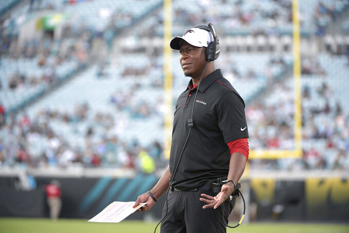 FILE - In this Aug. 19, 2019, file photo, Atlanta Falcons then-assistant head coach/passing game coordinator Raheem Morris watches from the sideline during the first half of a preseason NFL football game against the Jacksonville Jaguars, in Jacksonville, Fla. The Atlanta Falcons have named defensive coordinator Raheem Morris interim head coach after firing Dan Quinn.  (AP Photo/Phelan M. Ebenhack, File)