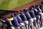 Milwaukee Brewers players watch from the dugout in the first inning of the team's spring baseball game against the Arizona Diamondbacks in Scottsdale, Ariz., Monday, March 1, 2021. (AP Photo/Jae C. Hong)