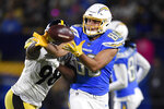 FILE - In this Oct. 13, 2019, file photo, Los Angeles Chargers tight end Hunter Henry, right, catches a pass while under pressure from Pittsburgh Steelers inside linebacker Vince Williams during the second half of an NFL football game, in Carson, Calif. The Chargers announced on Friday, March 13, 2020, that they have put the non-exclusive franchise tag on tight end Hunter Henry. General manager Tom Telesco said during the NFL Scouting Combine that they were considering tagging Henry but are still hoping to sign him to a long-term extension.(AP Photo/Kelvin Kuo, File)