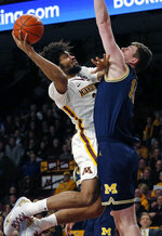 Minnesota's Jordan Murphy, left, goes for a layup as Michigan's Jon Teske tries to block the shot in the first half of an NCAA college basketball game Thursday, Feb. 21, 2019, in Minneapolis. (AP Photo/Jim Mone)