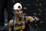Baylor guard Jared Butler celebrates as he walks off the court after the championship game against Gonzaga in the men's Final Four NCAA college basketball tournament, Monday, April 5, 2021, at Lucas Oil Stadium in Indianapolis. Baylor won 86-70. (AP Photo/Darron Cummings)