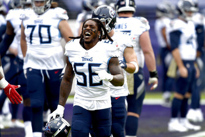 Tennessee Titans linebacker Daren Bates reacts while working out prior to an NFL football game against the Baltimore Ravens, Sunday, Nov. 22, 2020, in Baltimore. (AP Photo/Gail Burton)