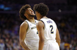 Michigan forward Isaiah Livers, left, celebrates with teammate Jordan Poole after making a basket during a second round men's college basketball game against Florida in the NCAA Tournament, Saturday, March 23, 2019, in Des Moines, Iowa. (AP Photo/Charlie Neibergall)