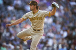 San Diego Padres starting pitcher Yu Darvish watches a throw to a Colorado Rockies batter during the first inning of a baseball game Tuesday, June 15, 2021, in Denver. (AP Photo/David Zalubowski)