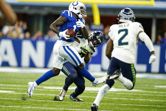 Indianapolis Colts wide receiver Parris Campbell (1) is hit by Seattle Seahawks strong safety Quandre Diggs (6) after a catch in the first half of an NFL football game in Indianapolis, Sunday, Sept. 12, 2021. (AP Photo/Charlie Neibergall)