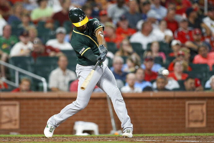 Oakland Athletics' Marcus Semien hits a solo home run during the fifth inning of the team's baseball game against the St. Louis Cardinals on Tuesday, June 25, 2019, in St. Louis. (AP Photo/Scott Kane)