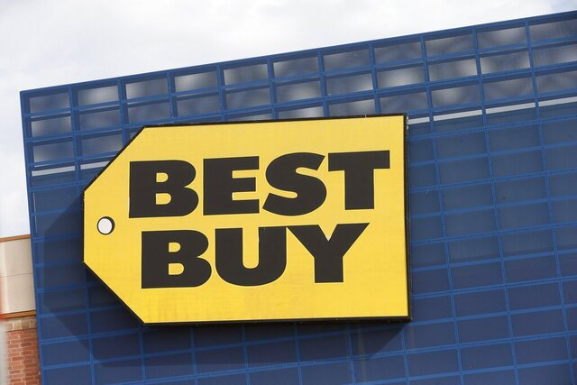 In this Aug. 27, 2019 photo, the Best Buy logo is shown on a store in Richfield, Minn.  Best Buy Co. reported that online sales more than tripled in the fiscal second quarter, Tuesday, Aug. 25, 2020, as shoppers bought computers, tablets and large appliances to help them cook, work and learn from home during the pandemic.    (AP Photo/Jim Mone)