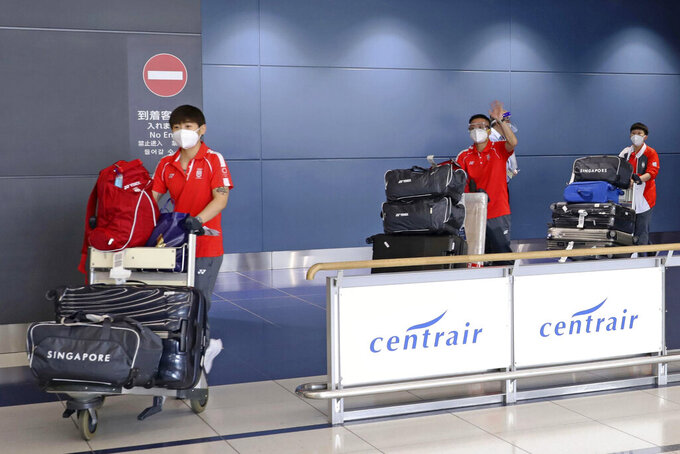 Singapore's table tennis team arrive at Chubu airport in Tokoname, central Japan, Sunday, June 27, 2021, ahead of the Tokyo 2020 Olympics starting from July. (Kyodo News via AP)